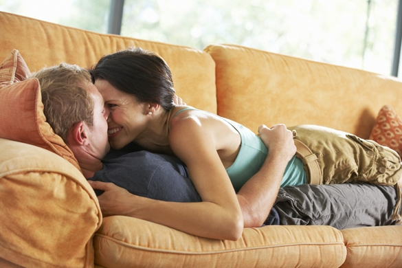 romantic-couple-lying-on-sofa-at-home