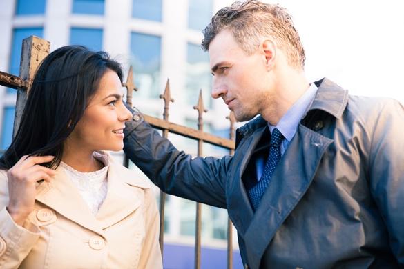 Beautiful woman and handsome Taurus man flirting outdoors