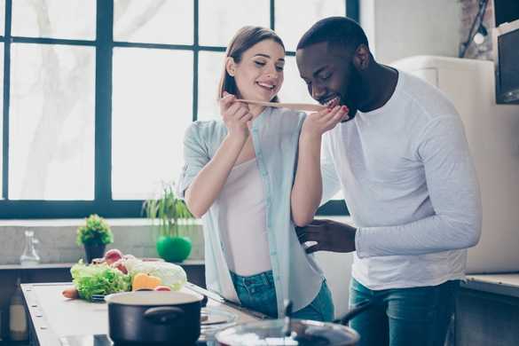 two lovely mixed race people together cooking healthy breakfast