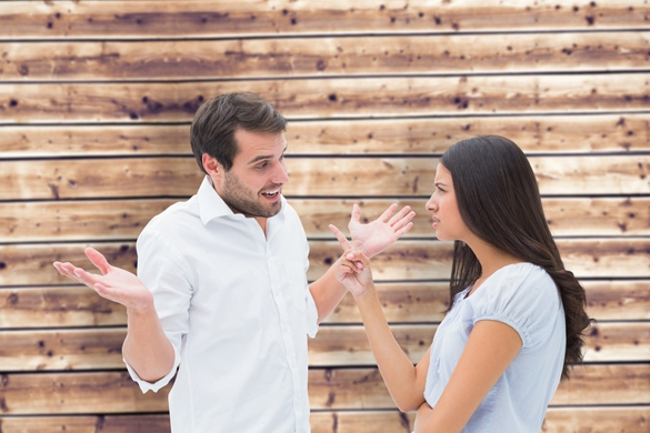 Angry brunette accusing her boyfriend against wooden planks background - Taurus Man And Gemini Woman Breakup