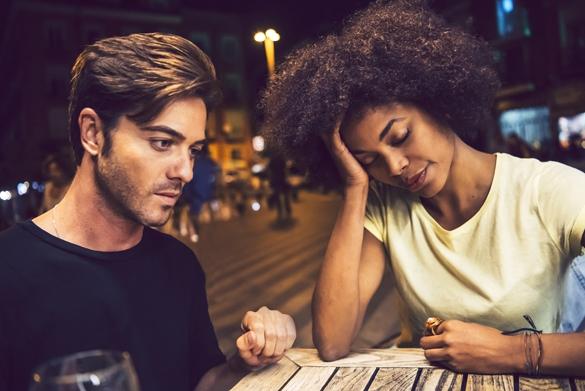 Casual interracial couple having an argument in a terrace - Taurus Man and Aquarius Woman Breakup