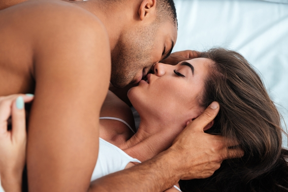 Sensual young couple kissing and making love in bed at home - Taurus Man In Bed With Cancer Woman