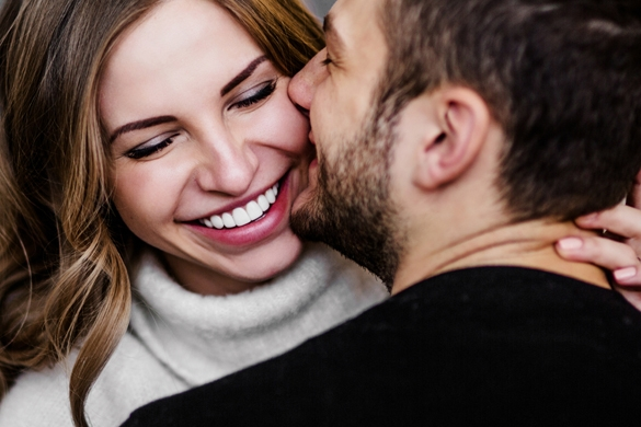 Young couple in love hug each other - what does a taurus man like about the scorpio woman