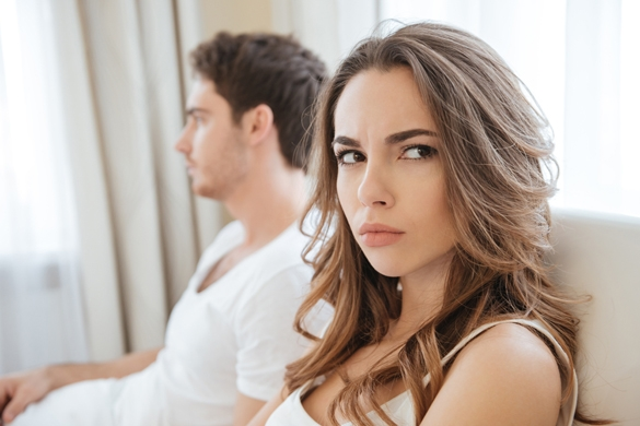 Sad unhappy young couple having problems in bed - Taurus Man and Sagittarius Woman Breakup