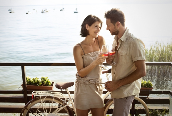 couple in love having spritz time with lake view - What Does a Taurus Man Like in a Capricorn Woman